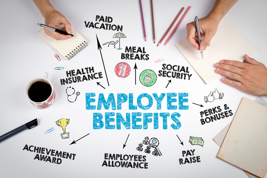 Employee Benefits Concept. The meeting at the white office table.